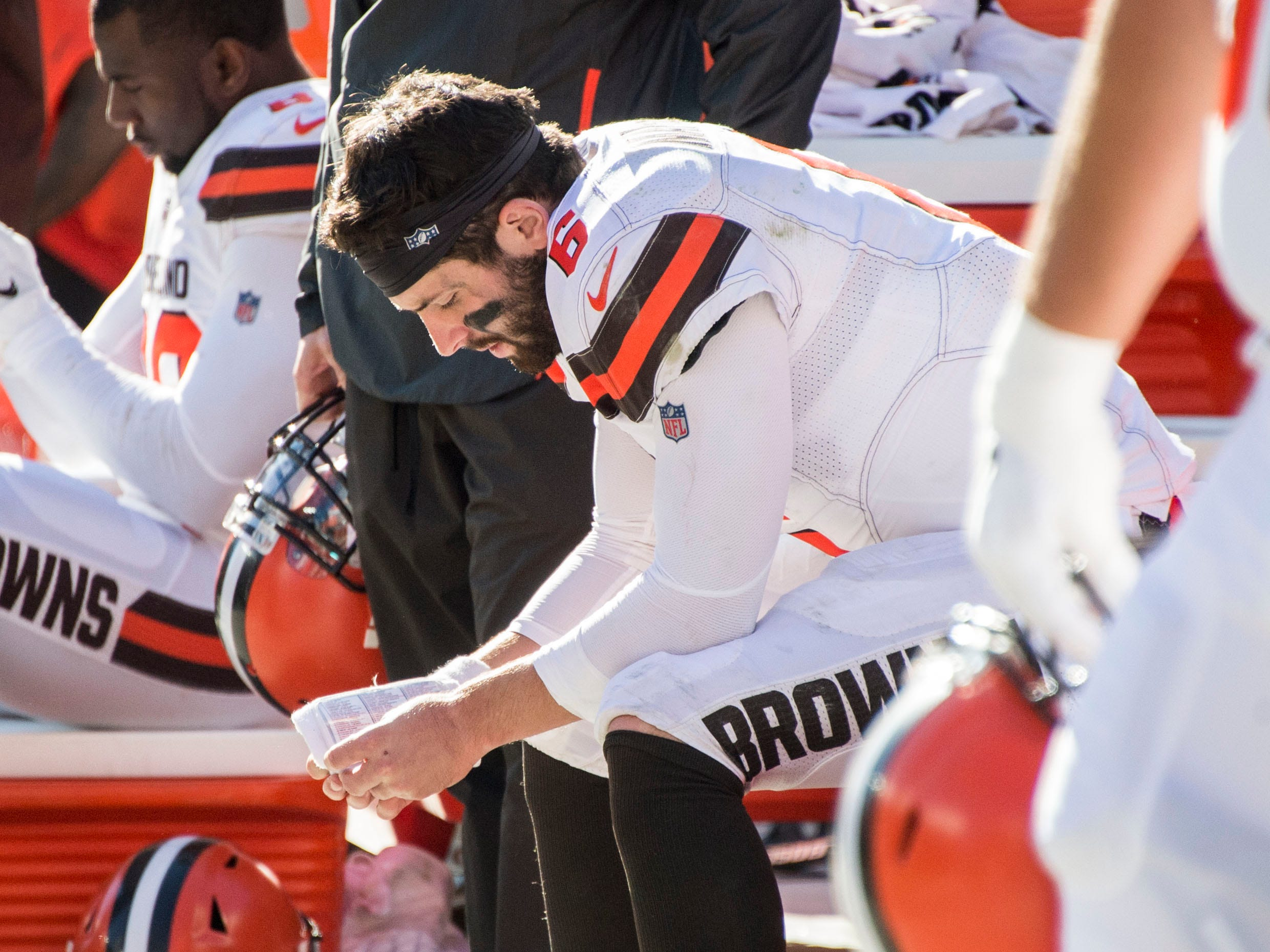 Cleveland Browns quarterback Baker Mayfield sits on the bench late in the fourth quarter against the Los Angeles Chargers at FirstEnergy Stadium. The Browns lost to the Chargers, 38-14.