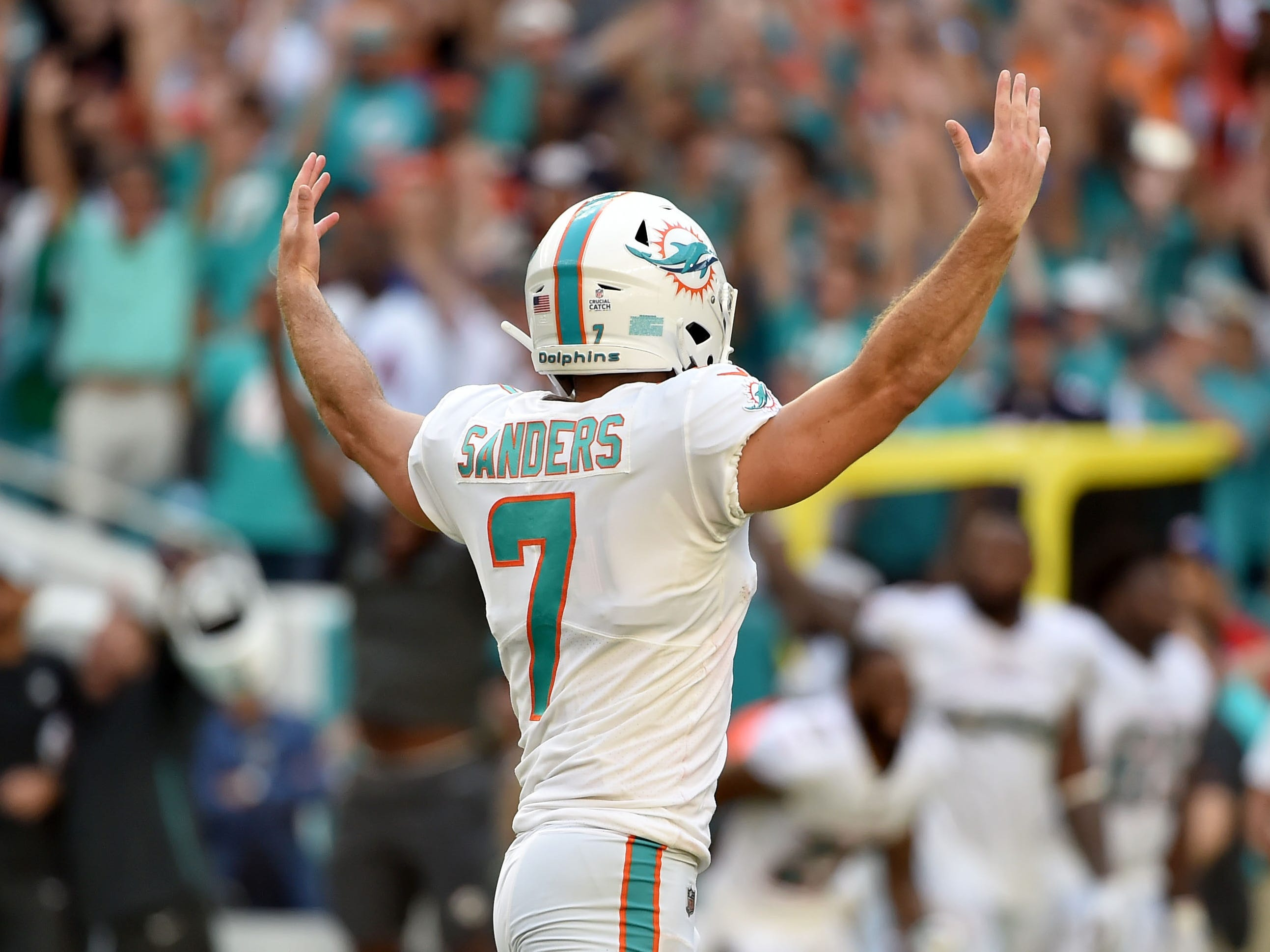 Miami Dolphins kicker Jason Sanders celebrates after kicking the game winning field goal in overtime against the Chicago Bears at Hard Rock Stadium.