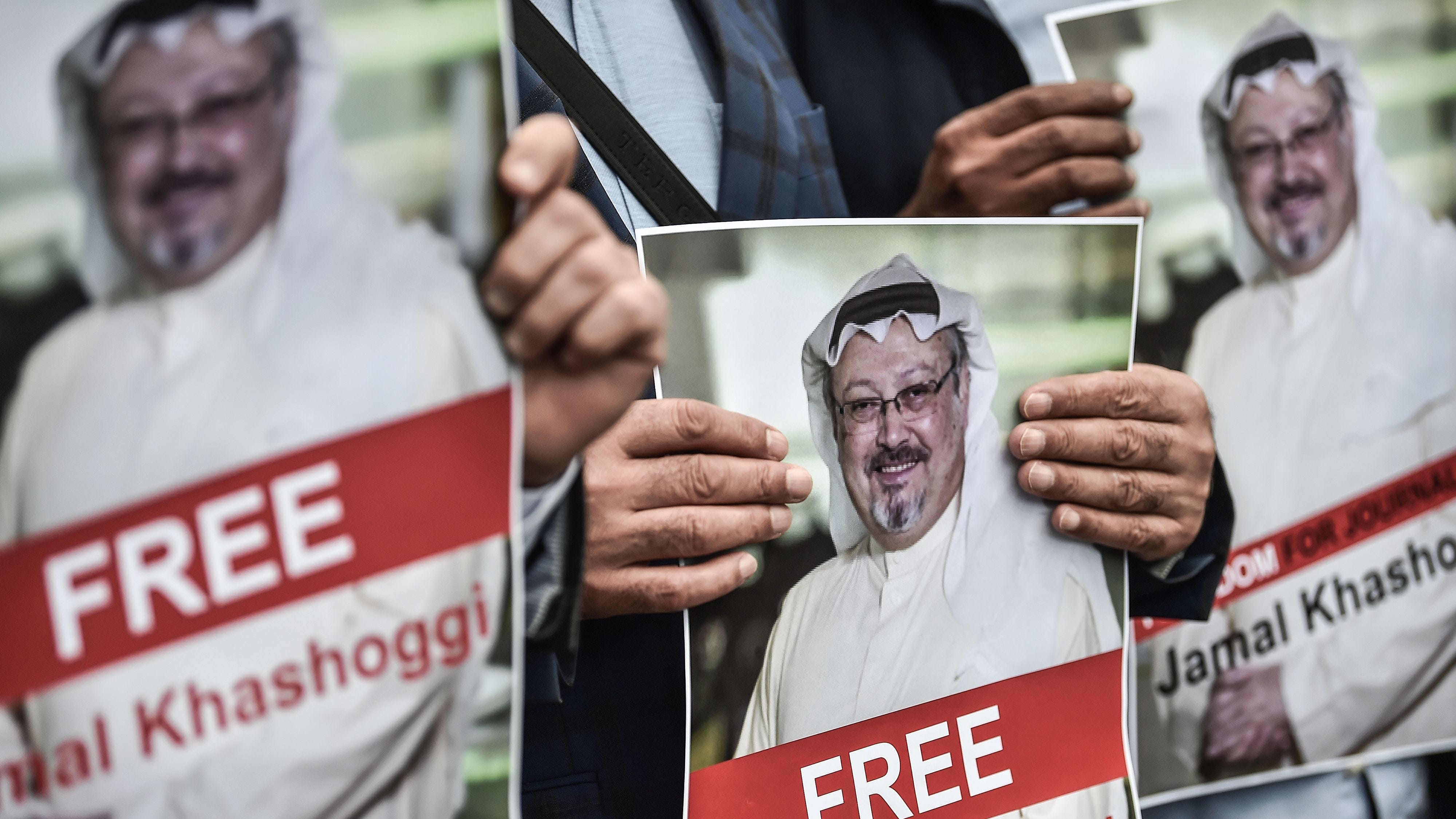 Protestors hold pictures of missing journalist Jamal Khashoggi during a demonstration in front of the Saudi Arabian consulate, Oct, 8, 2018 in Istanbul.