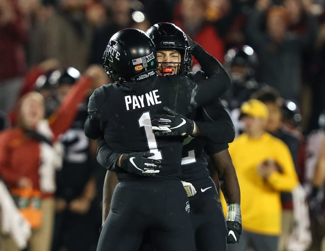 Iowa State Cyclones defensive backs D'Andre Payne (1) and Greg Eisworth celebrate after intercepting a pass in the second half against the West Virginia Mountaineers at Jack Trice Stadium.