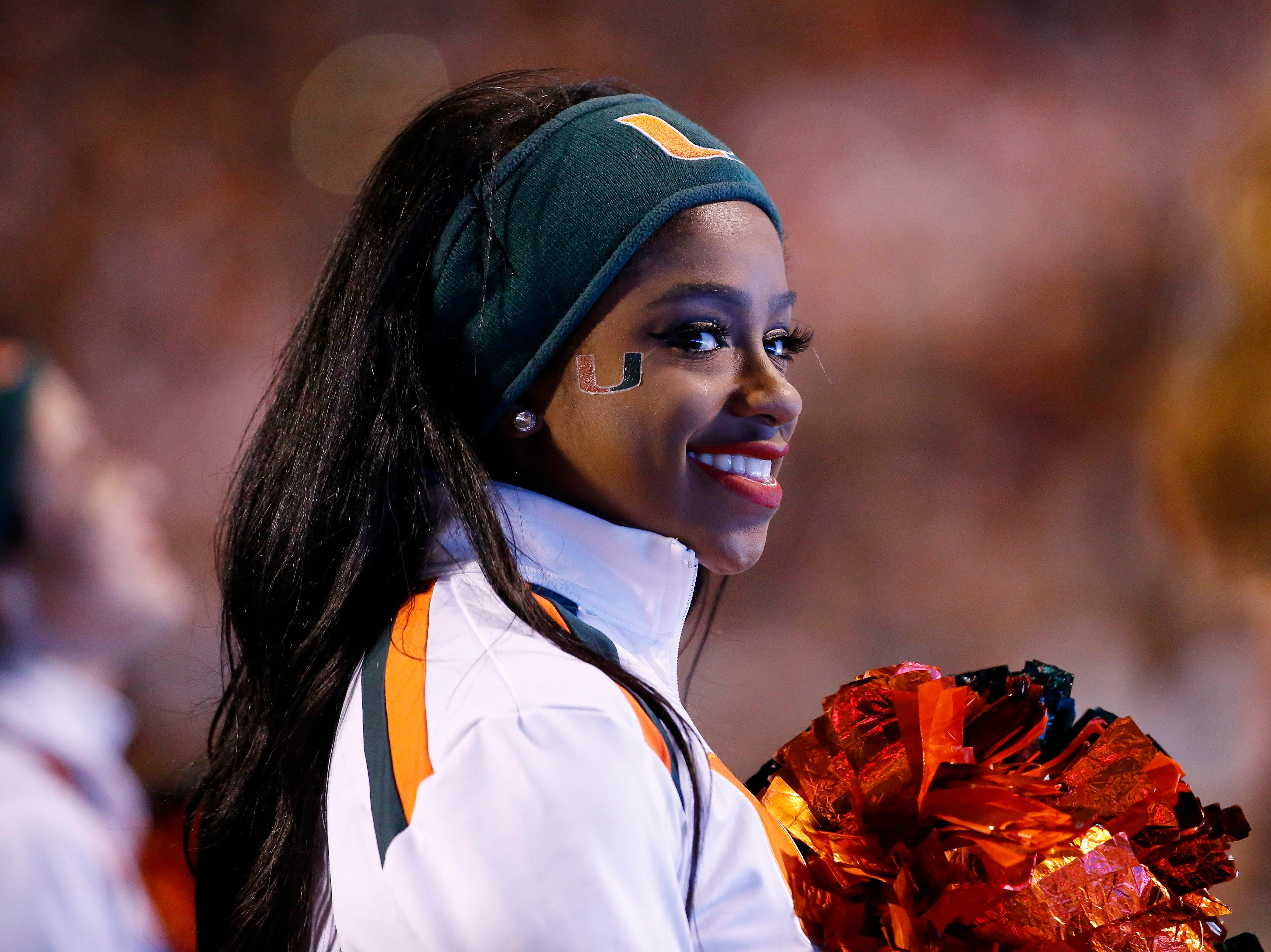 Week 7: A Miami Hurricanes cheerleader looks on from the sidelines during the second half against the Virginia Cavaliers at Scott Stadium.