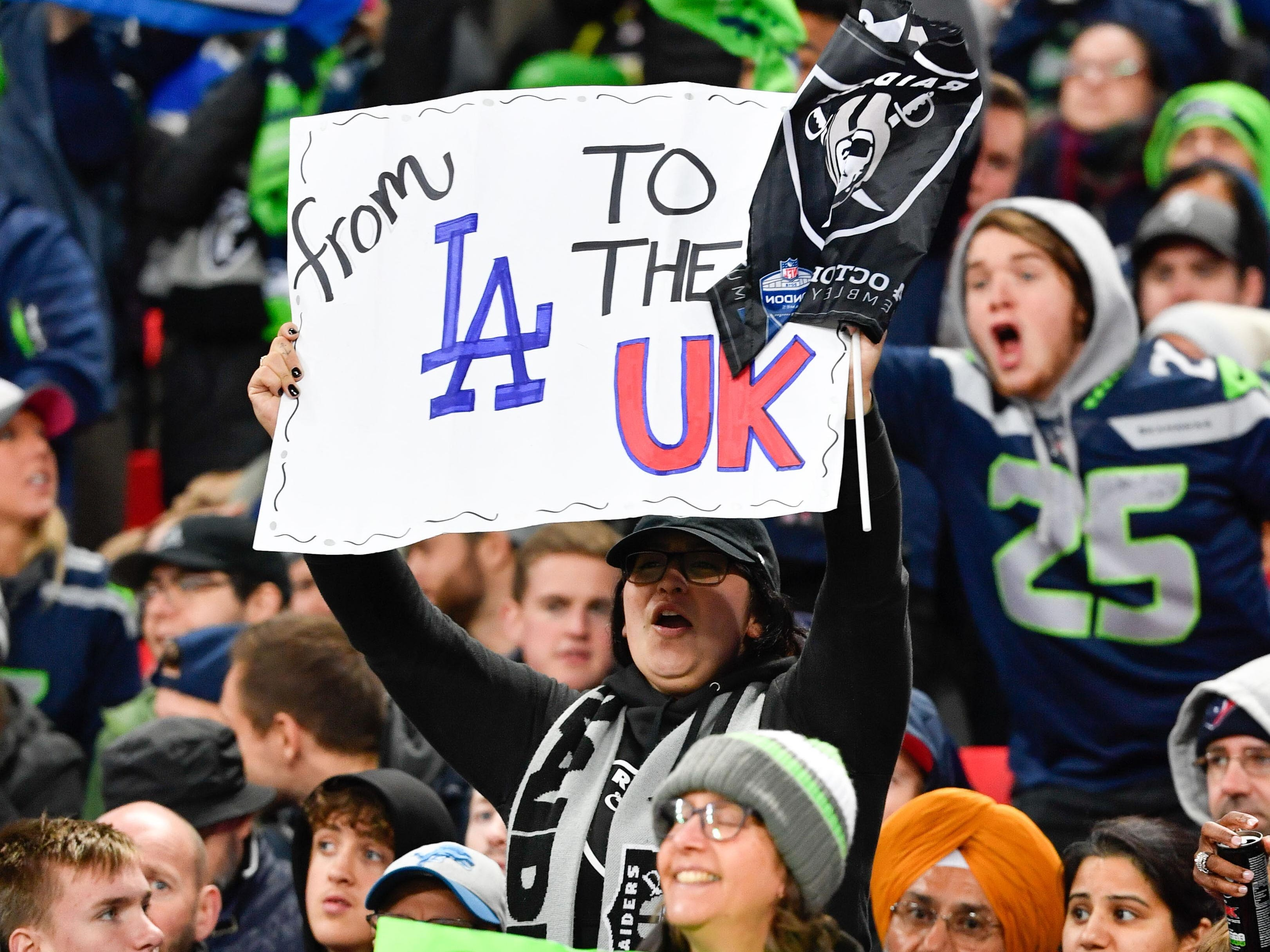 Fans cheer during the game between the Oakland Raiders and the Seattle Seahawks at Wembley Stadium in London.