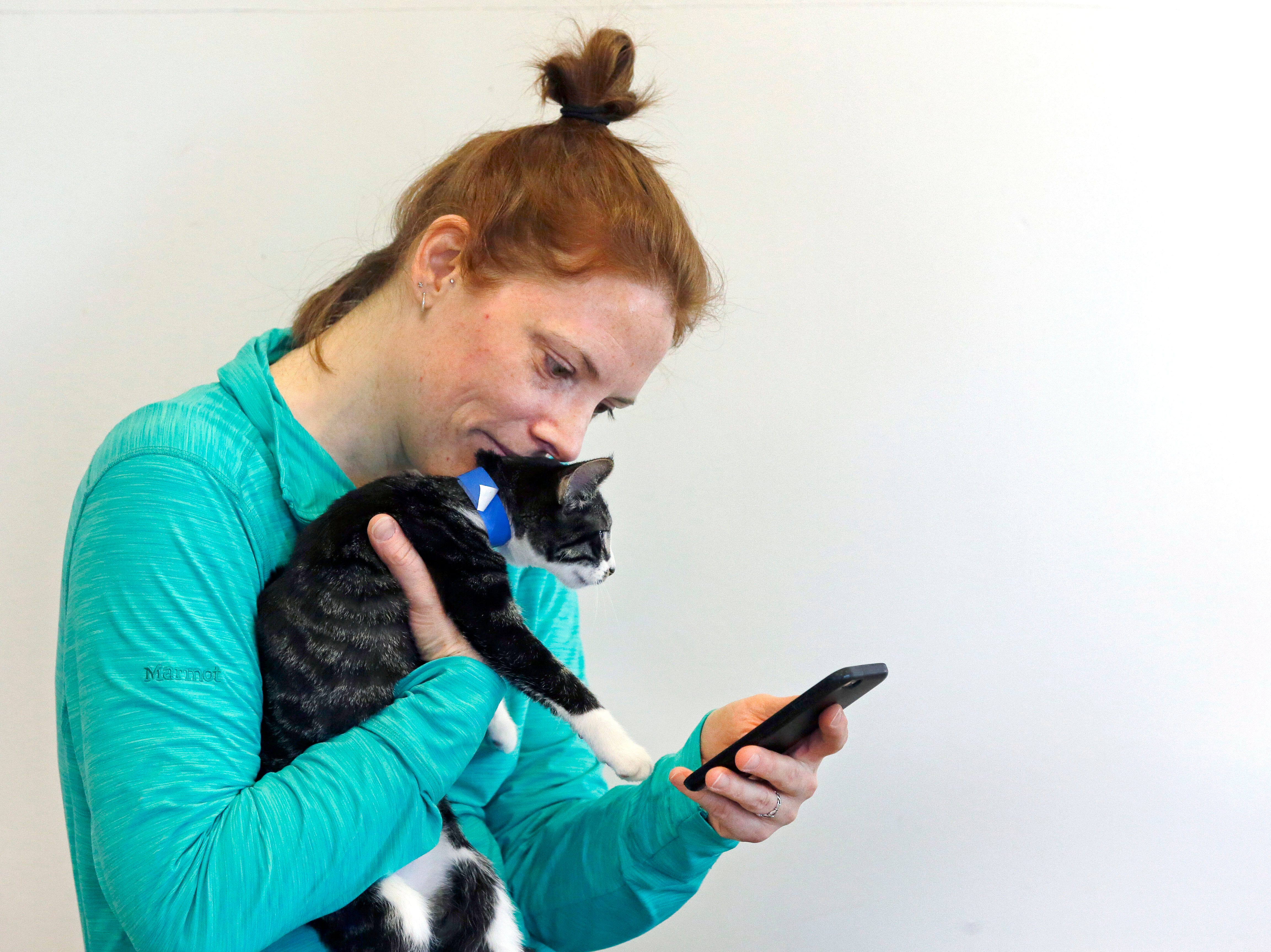 Shawn Murphy gets a selfie with a kitten as the Fox Valley Humane Association and Grace Under Fire Yoga bring together adoptable kittens and yoga class for Kitten Yoga on Saturday, Oct. 13, 2018, at the Fox Valley Humane Association in Appleton, Wis.