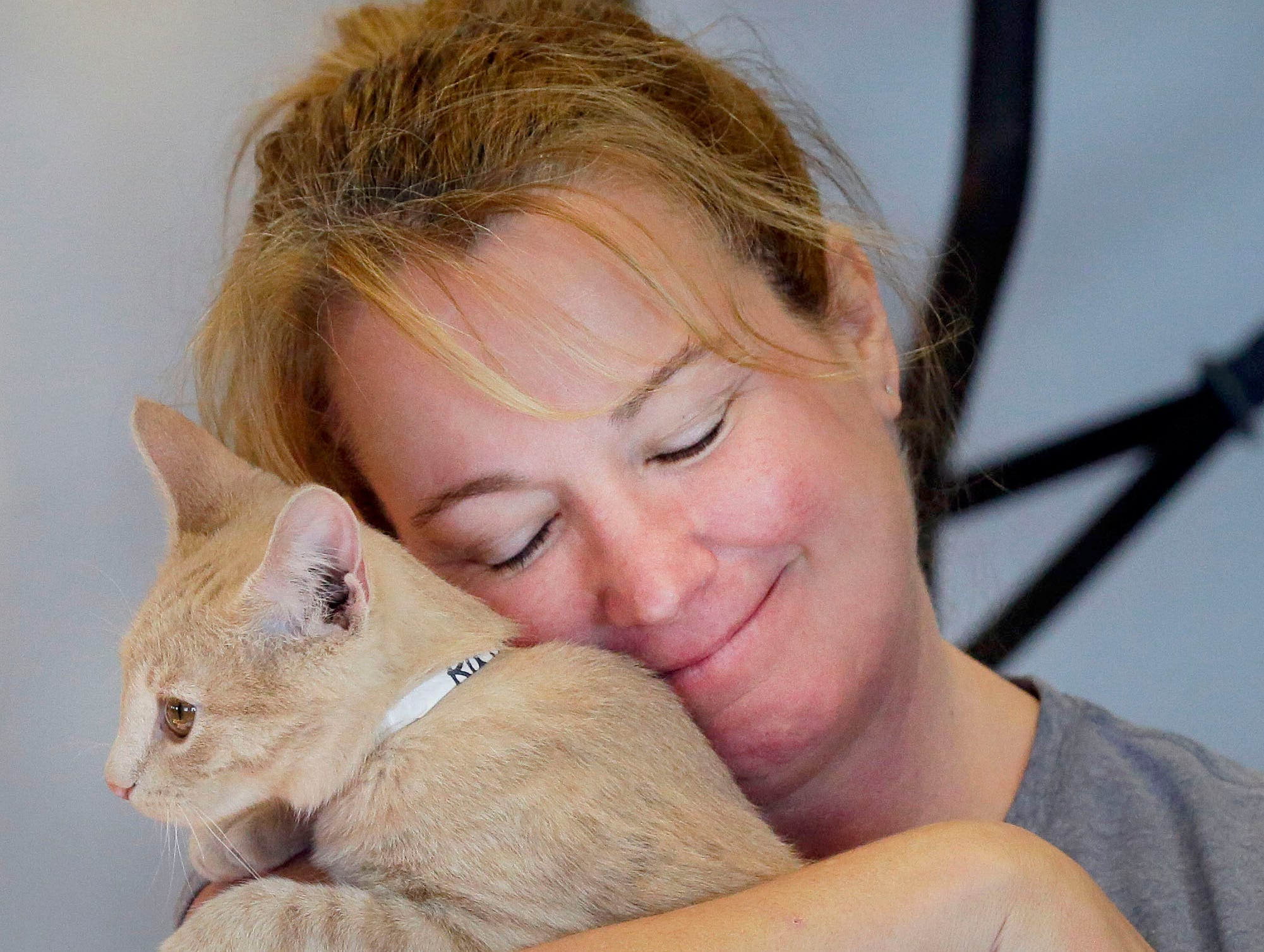 Wendy Sontag hugs a kitten as the Fox Valley Humane Association and Grace Under Fire Yoga bring together adoptable kittens and yoga class for Kitten Yoga on Saturday, Oct. 13, 2018, at the Fox Valley Humane Association in Appleton, Wis.