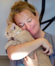 Wendy Sontag hugs a kitten at the Fox Valley Humane Association in Appleton Oct. 13 during an event that brought together adoptable kittens and yoga.