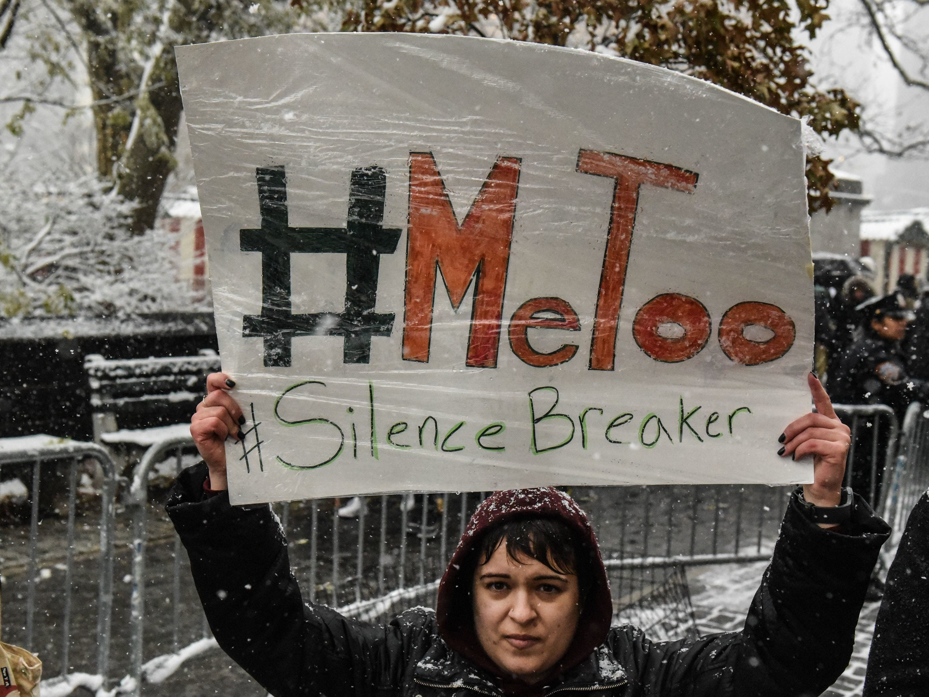 People protest sexual harassment at a #MeToo rally outside Trump International Hotel on Dec.9.   Photos by Getty Images People carry signs addressing the issue of sexual harassment at a #MeToo rally outside of Trump International Hotel on December 9, 2017.