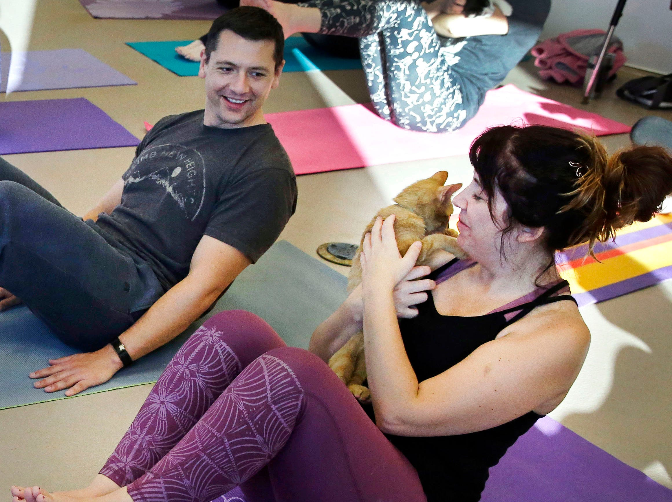 Brice and Lindsey Trickey take part in class and visit with a kitten as the Fox Valley Humane Association and Grace Under Fire Yoga bring together adoptable kittens and yoga class for Kitten Yoga on Saturday, Oct. 13, 2018, at the Fox Valley Humane Association in Appleton, Wis.