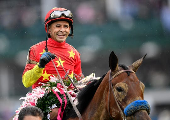 Mike Smith aboard Abel Tasman (13) celebrates after winning the 2017 Kentucky Oaks at Churchill Downs.