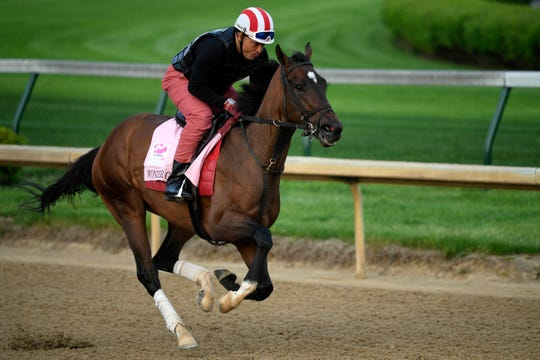 An exercise rider works Kentucky Oaks entry Wonder Gadot at Churchill Downs.