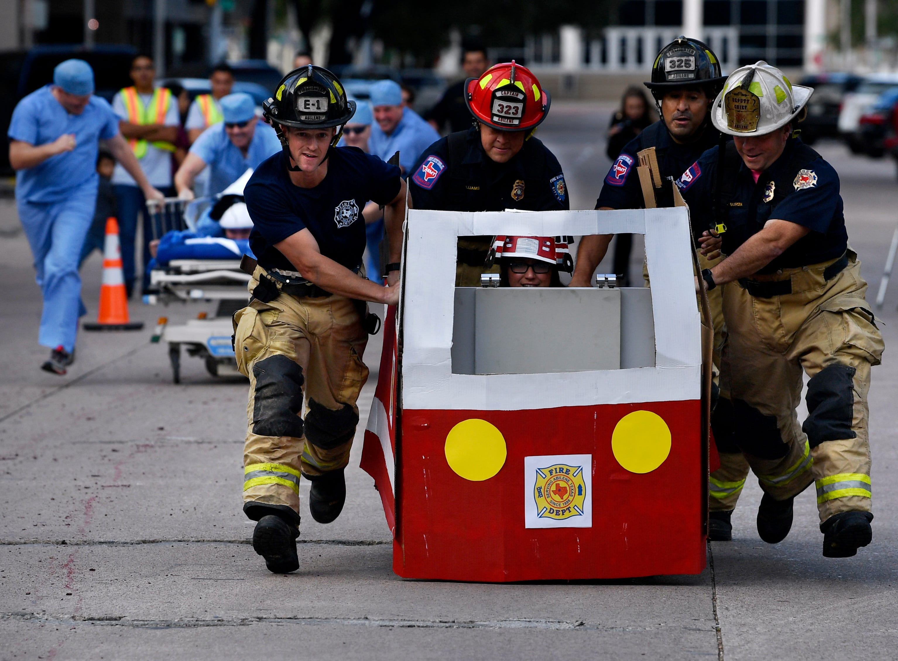 The Abilene Fire Department gurney is leading during The Great Gurney Race Thursday.