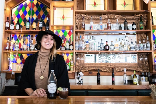 Jillian Trashley, owner of the Nohm Project, a company that makes herbal drinks, and a bartender at the Block Off Biltmore, with one of her non-alcoholic drinks, the Plant Pop, which contains lemon balm, lemongrass, stinging nettle, oat straw, simple syrup and club soda.