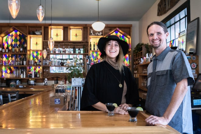 Jillian Trashley, owner of the Nohm Project, a company that makes herbal drinks, and Jimmy Gallagher, owner of Asheville Dispensary, a dispensary of cannabidiol, or CBD, at the Block Off Biltmore, with the Hydration Mertini, a non-alcoholic cocktail containing CO2 extract of rosemary, chlorophyl, club soda, lime and salt.