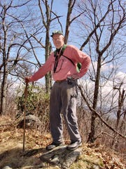 Walt Weber, of Brevard, stands atop Green Knob on the Mountains-to-Sea Trail. He has just released the third edition of his MST hiking guide.