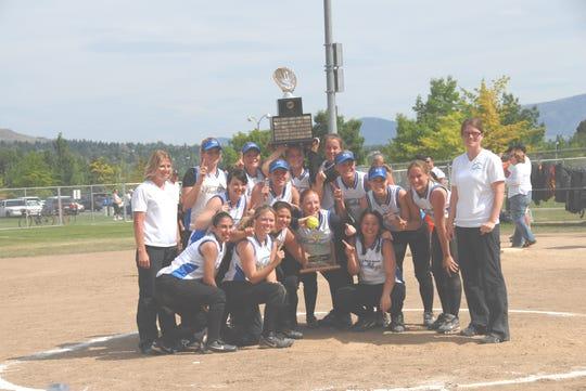 The North Mason Bulldogs celebrate after winning a state softball championship