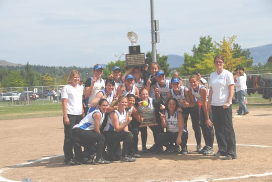 The North Mason Bulldogs celebrate after winning a state softball championship