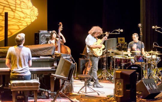 Pat Metheny gets into the middle of the music made by bandmates (from left) Gwilym Simcock on piano, Linda May Han Oh on bass and Antonio Sanchez on drums.