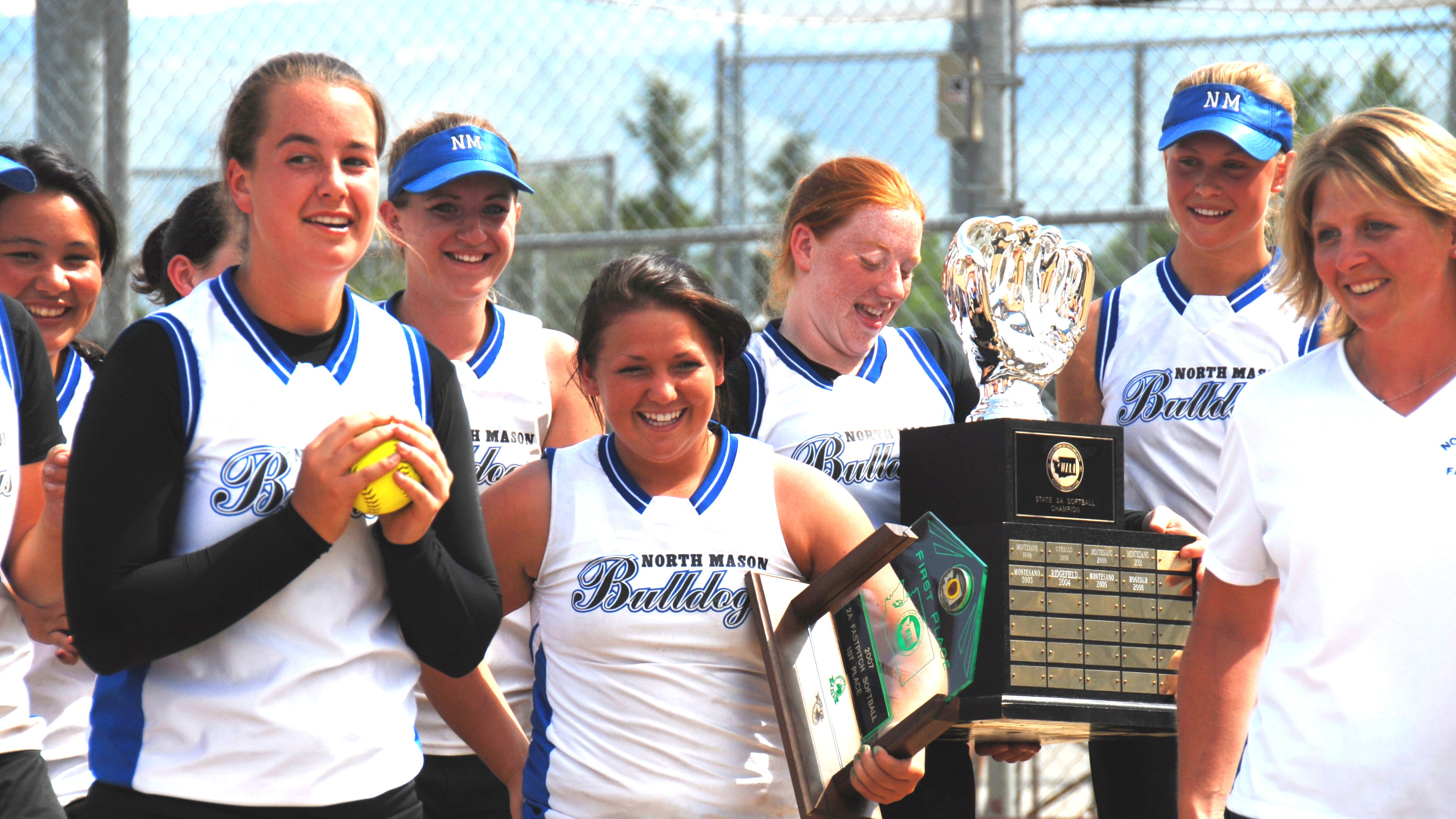 North Mason's 2007 softball state championship team included, from left, Katelyn Stanley (with ball), Kylee Hull, Anna Heitstuman, Hannah Marshall and coach Paula Grande.