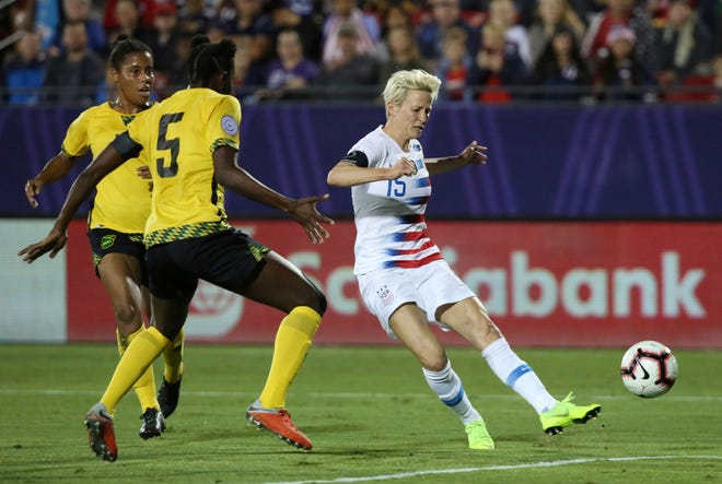 United States forward Megan Rapinoe scores during Sunday's World Cup qualifying match against Jamaica in Frisco, Texas. Rapinoe plays for the Seattle Reign in the NWSL.