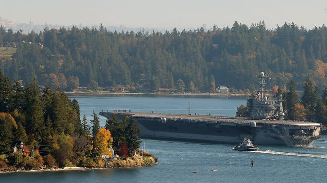 The USS John C. Stennis moves through Rich Passage after leaving Naval Base Kitsap-Bremerton on Monday, October 15, 2018.