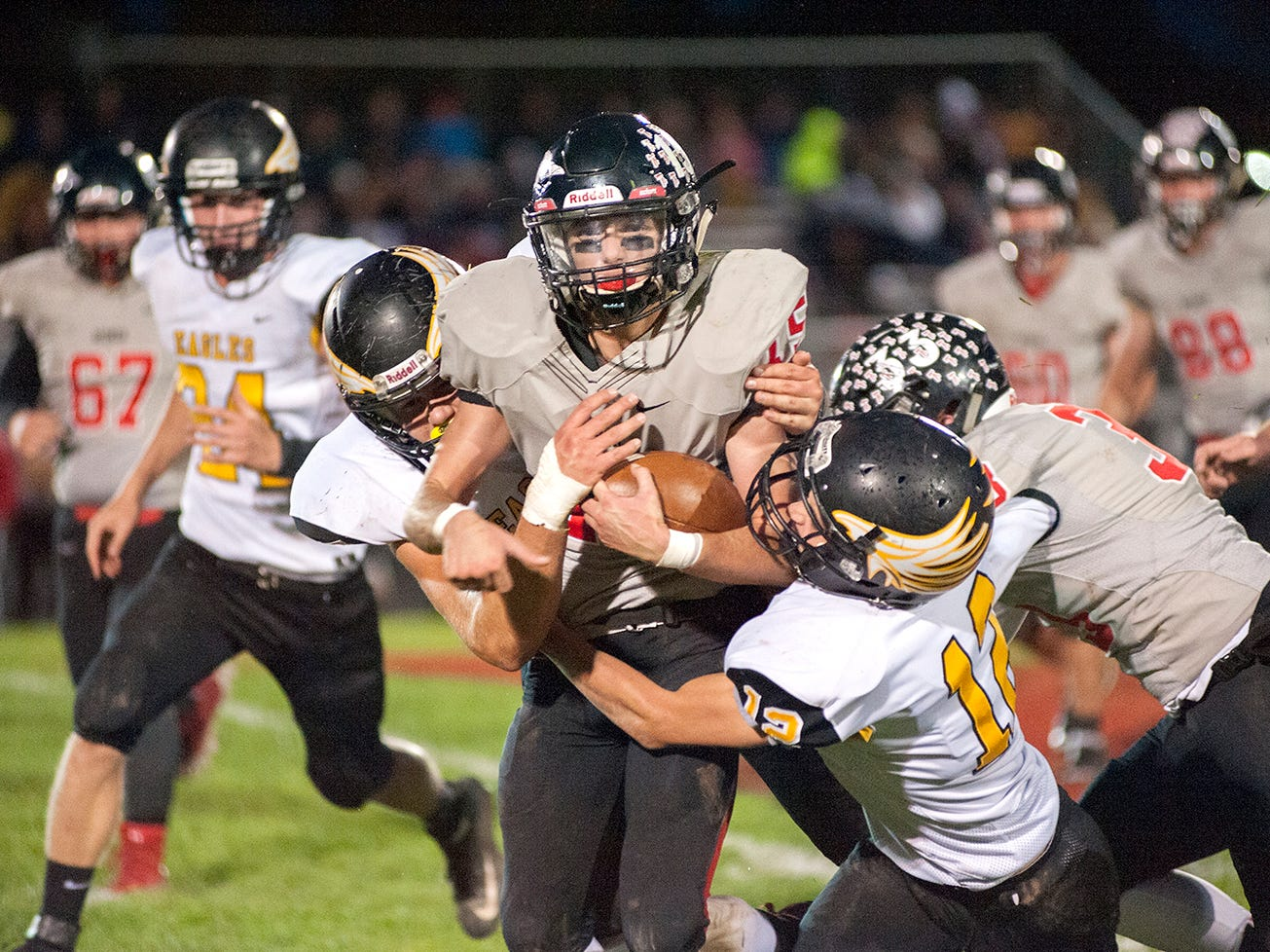 Bucyrus' Hastin Zier is tackled by the Colonel Crawford defense.