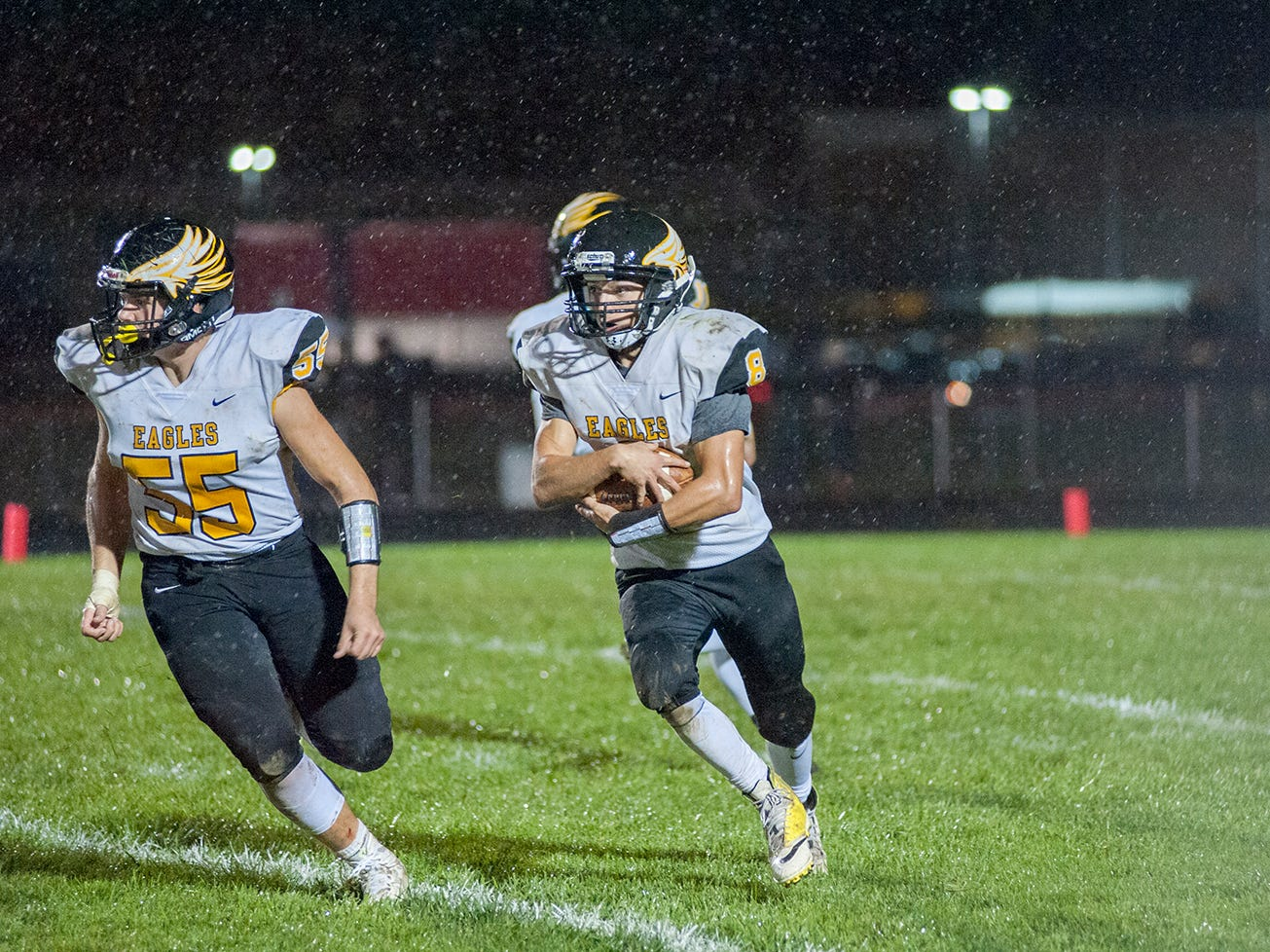 Colonel Crawford's Colton Rowland holds the ball tight in rainy conditions.