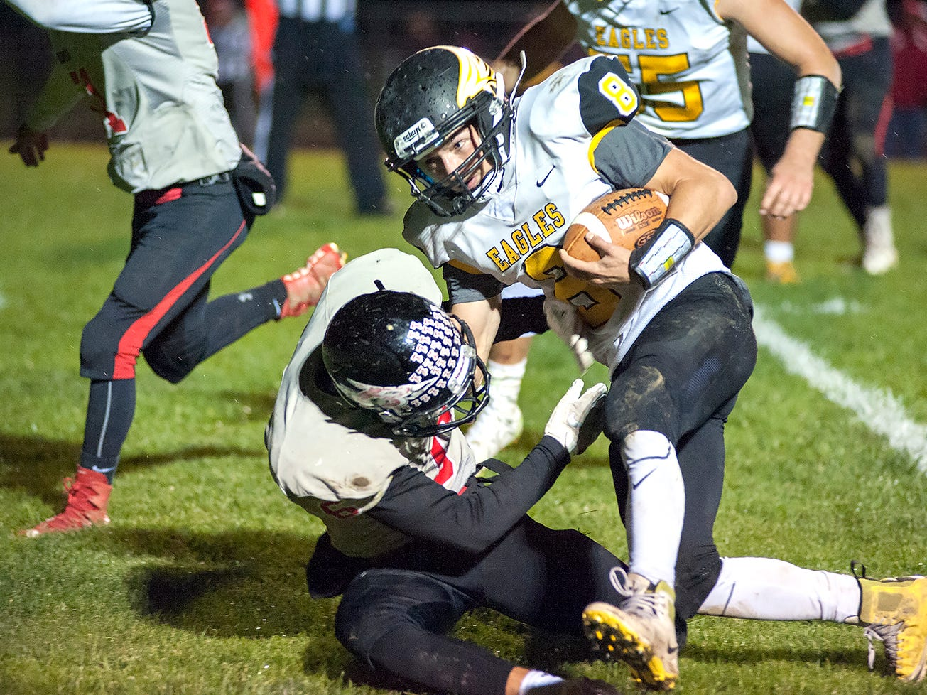 Colonel Crawford's Colton Rowland is brought down by Bucyrus' Lincoln Mollenkopf.