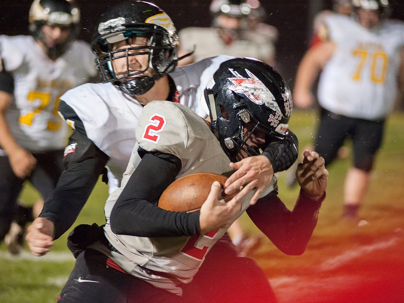 Bucyrus' Ben Seibert is tackled while scrambling.