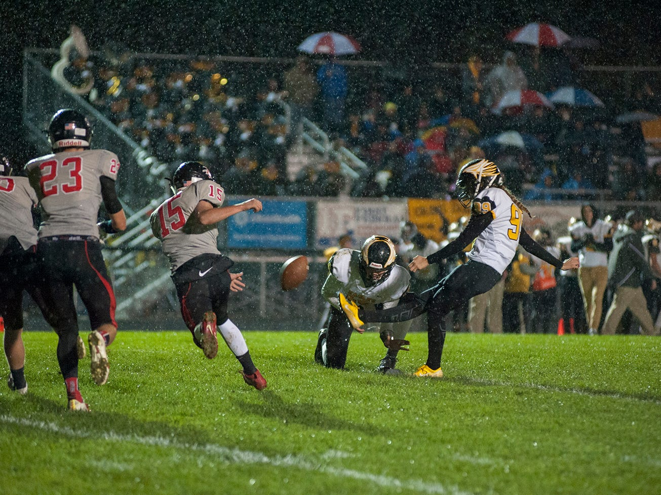 Colonel Crawford's Drew Krassow kicks an extra point.