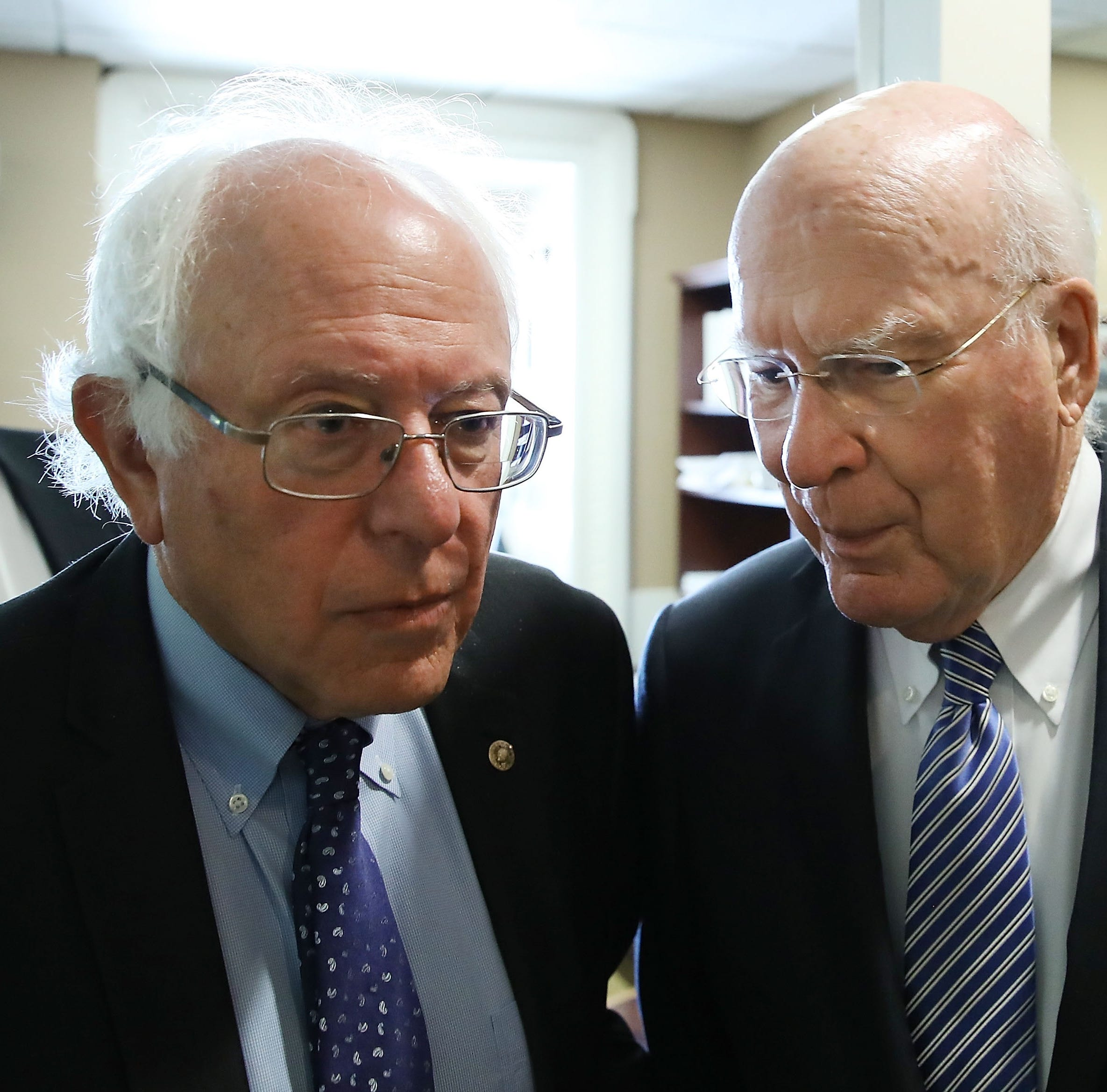 Sen. Bernie Sanders,  I-Vt., left, and Sen. Patrick Leahy, D-Vt., arrive at a news conference regarding genetically engineered food labeling, on Capitol Hill, July 6, 2016 in Washington, DC.