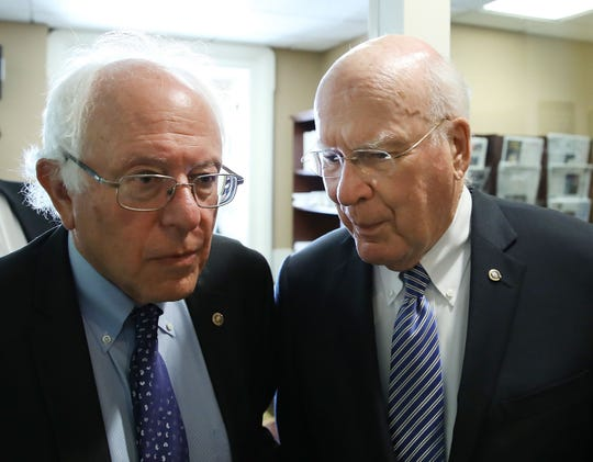 Sen. Bernie Sanders, I-Vt., left, and Sen. Patrick Leahy, D-Vt., arrive at a news conference on Capitol Hill, July 6, 2016 in Washington, DC.