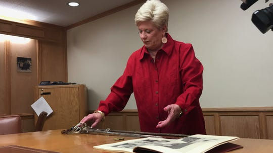 Nancy Deviney, granddaughter of former Corpus Christi Chief of Police James Shaw, holds Shaw's sword at the department Monday, Oct. 15, 2018. Deviney donated Shaw's badge and a yearbook from the 1920s, when he was chief.