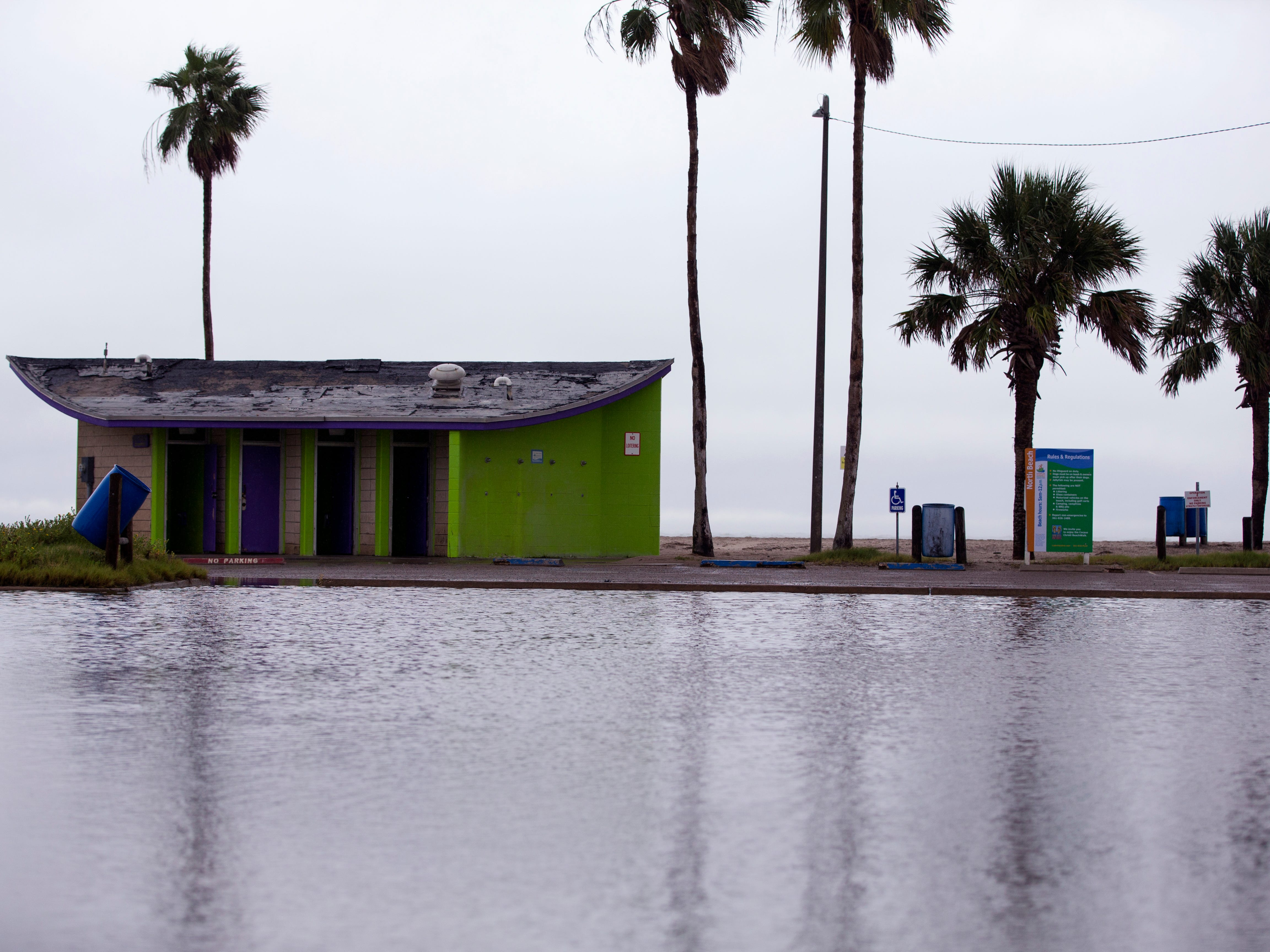 The roadway and parking lot next to these bathrooms on North Beach were flooded as a cold front and rain moved through the area on Monday, October 15, 2018.