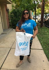Kelly Ikalina, a driver working for goPuff, makes a delivery in Haddonfield.