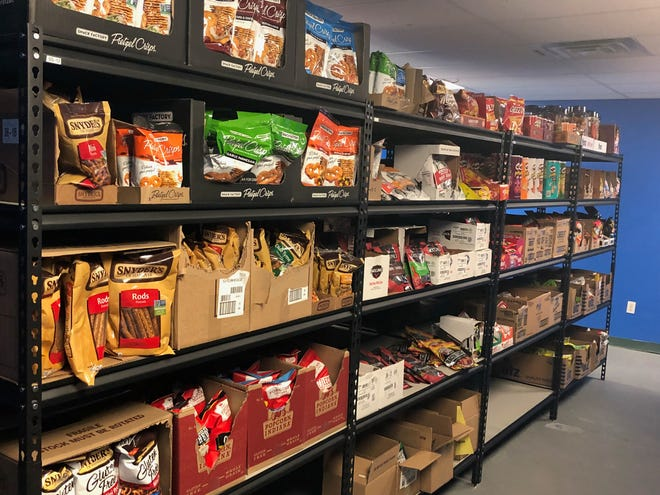 GoPuff's Cherry Hill warehouse is filled with 2,000 varieties of snacks and other items available for delivery.
