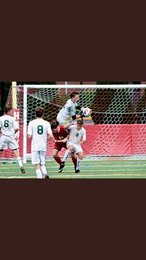 Haddon Township goalie  Brett Hintz, center, goes up for a leaping save in a recent game.