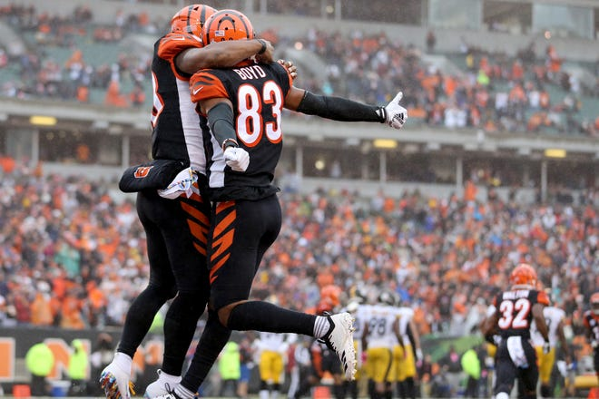 Cincinnati Bengals running back Joe Mixon (28) and Cincinnati Bengals wide receiver Tyler Boyd (83) celebrate Boyd's second touchdown in the secibd quarter during the Week 6 NFL game between the Pittsburgh Steelers and the Cincinnati Bengals, Sunday, Oct. 14, 2018, at Paul Brown Stadium in Cincinnati. It was tied 14-14 at the half.