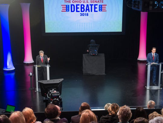Sen. Sherrod Brown, D-Ohio, left, speaks and Rep. Jim Renacci, R-Ohio, listens during a debate at the Idea Center in Playhouse Square, Sunday, Oct. 14, 2018, in Cleveland.