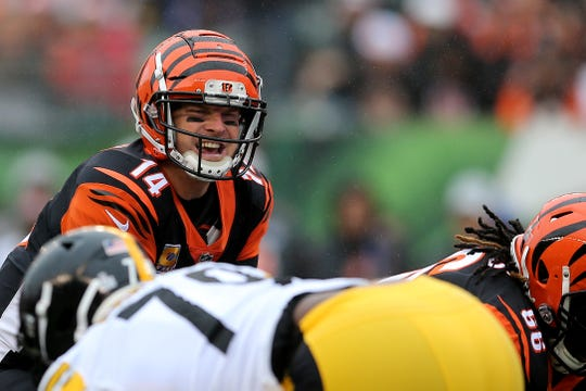 Cincinnati Bengals quarterback Andy Dalton (14) calls a play before the snap during the Week 6 NFL game between the Pittsburgh Steelers and the Cincinnati Bengals, Sunday, Oct. 14, 2018, at Paul Brown Stadium in Cincinnati. It was tied 14-14 at the half.
