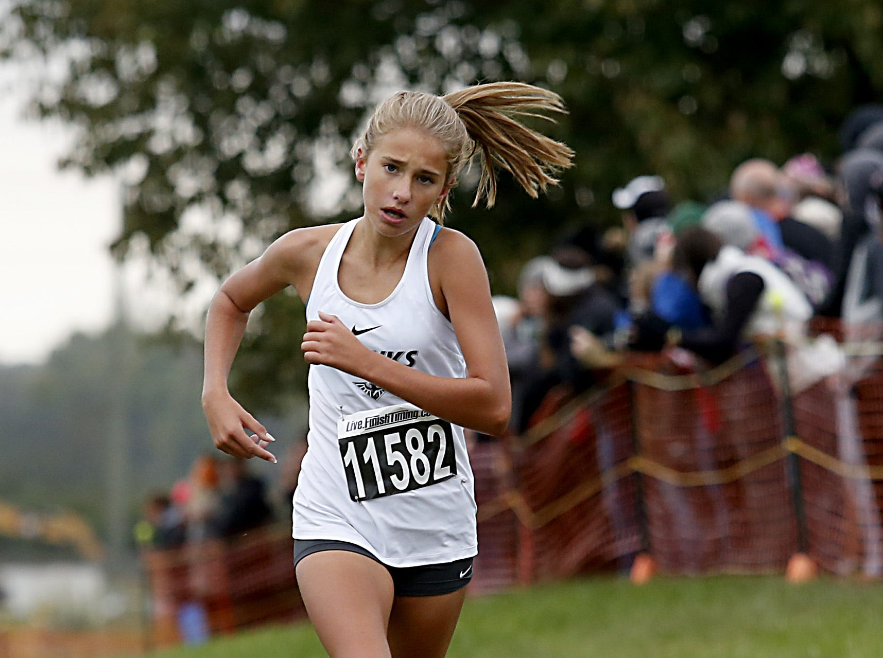 Cali Reynolds of Lakota East finishes seventh during the Greater Miami Conference Girls and Boys Cross Country Championships at Voice of America Park in West Chester Saturday, Oct. 13, 2018.