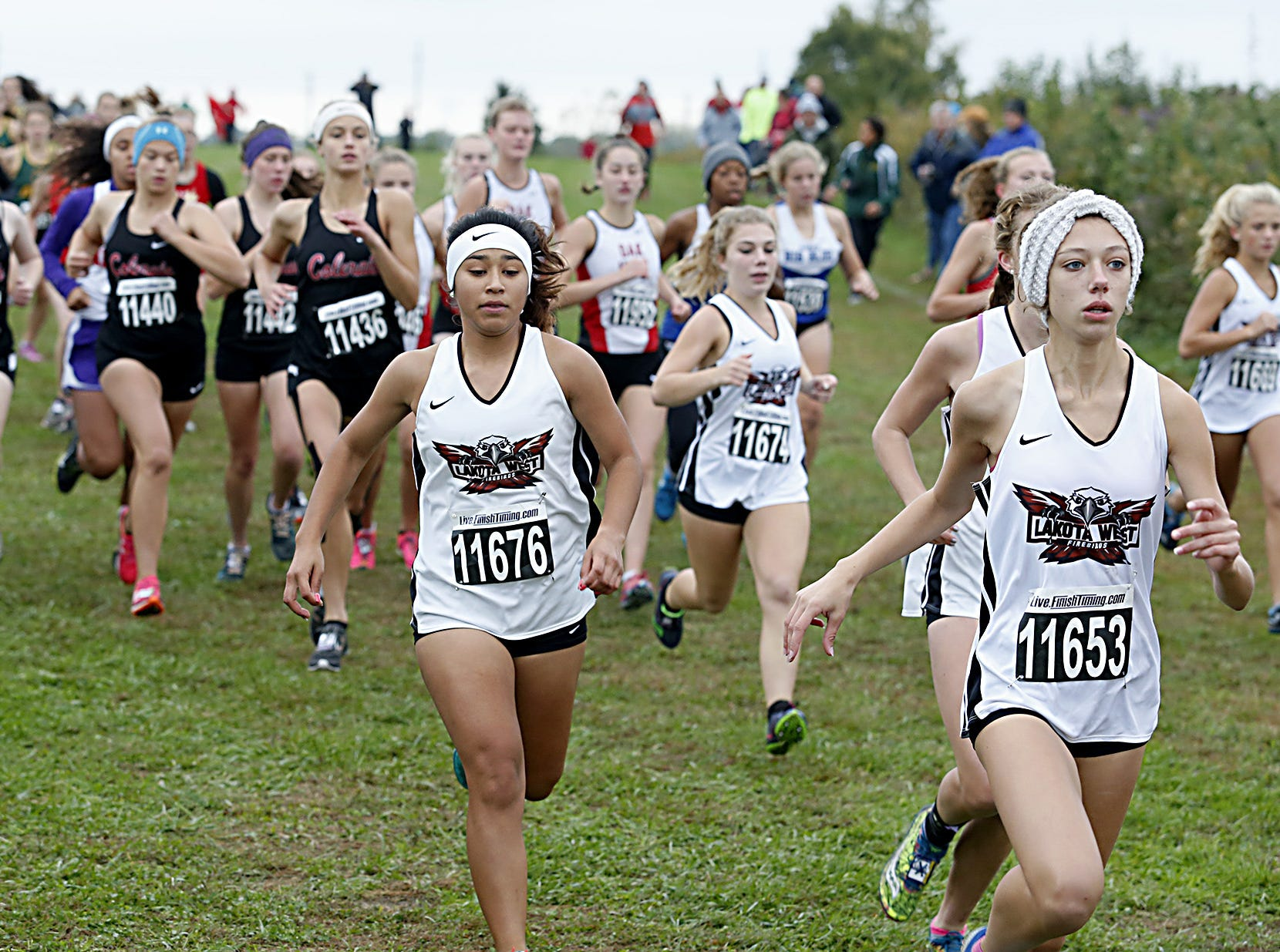 Lakota West girls begin their race during the Greater Miami Conference Girls and Boys Cross Country Championships at Voice of America Park in West Chester Saturday, Oct. 13, 2018.