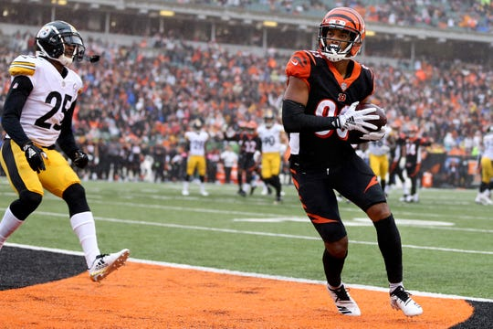 Cincinnati Bengals wide receiver Tyler Boyd (83) catches.a touchdown pass during the Week 6 NFL game between the Pittsburgh Steelers and the Cincinnati Bengals, Sunday, Oct. 14, 2018, at Paul Brown Stadium in Cincinnati. It was tied 14-14 at the half.