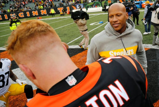 Injured Pittsburgh Steelers linebacker Ryan Shazier (50) shakes hands with Cincinnati Bengals quarterback Andy Dalton (14) after the fourth quarter of the NFL Week 6 game between the Cincinnati Bengals and the Pittsburgh Steelers at Paul Brown Stadium in downtown Cincinnati on Sunday, Oct. 14, 2018. The Bengals and Steelers exchanged late touchdowns, with the Pittsburgh coming out on top, 28-21.