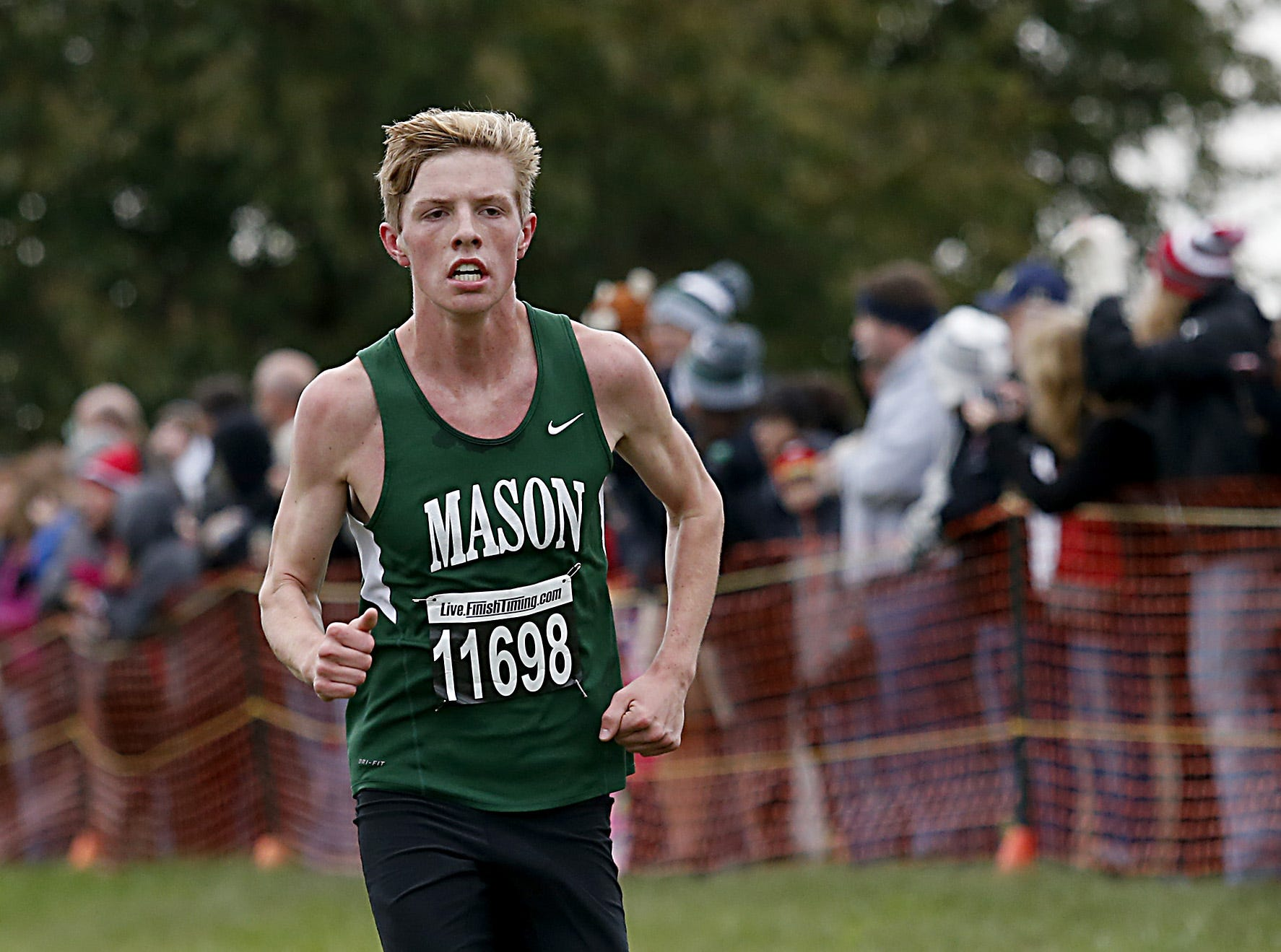 Mason's Austin Cooper finishes eighth during the Greater Miami Conference Girls and Boys Cross Country Championships at Voice of America Park in West Chester Saturday, Oct. 13, 2018.