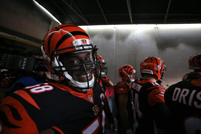 Cincinnati Bengals defensive end Carl Lawson (58) smiles  before taking the field in the tunnel before the Week 6 NFL game between the Pittsburgh Steelers and the Cincinnati Bengals, Sunday, Oct. 14, 2018, at Paul Brown Stadium in Cincinnati. It was tied 14-14 at the half.