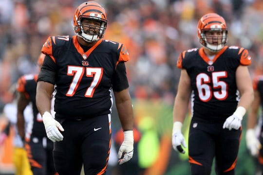 Cincinnati Bengals offensive tackle Cordy Glenn (77) walks back to the huddle after a holding penalty during the Week 6 NFL game between the Pittsburgh Steelers and the Cincinnati Bengals, Sunday, Oct. 14, 2018, at Paul Brown Stadium in Cincinnati. The Pittsburgh Steelers won 28-21.