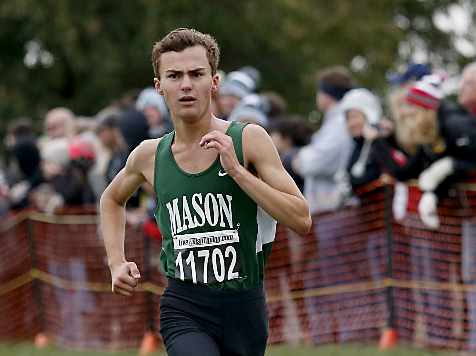 Mason's Brennan Doran finishes ninth during the Greater Miami Conference Girls and Boys Cross Country Championships at Voice of America Park in West Chester Saturday, Oct. 13, 2018.