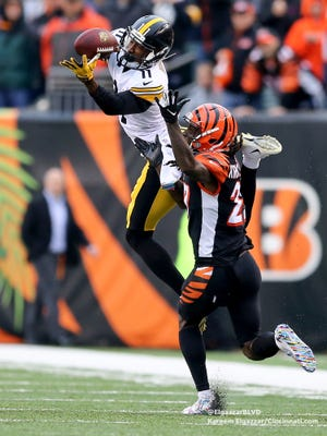 Pittsburgh Steelers wide receiver Justin Hunter (11) turns back for the ball as Cincinnati Bengals cornerback Dre Kirkpatrick (27) defends in the fourth quarter during the Week 6 NFL game between the Pittsburgh Steelers and the Cincinnati Bengals, Sunday, Oct. 14, 2018, at Paul Brown Stadium in Cincinnati. The Pittsburgh Steelers won 28-21.