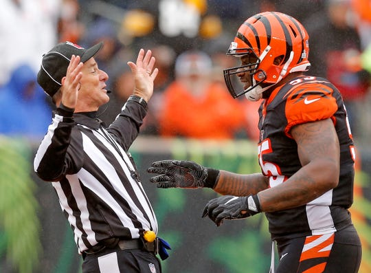 Cincinnati Bengals linebacker Vontaze Burfict (55) jokes with an official after a touchdown run by Pittsburgh Steelers running back James Conner (30) in the second quarter of the NFL Week 6 game between the Cincinnati Bengals and the Pittsburgh Steelers at Paul Brown Stadium in downtown Cincinnati on Sunday, Oct. 14, 2018. The game was tied 14-14 at half time.