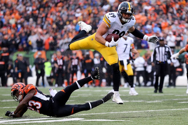 Pittsburgh Steelers tight end Vance McDonald (89) leaps over Cincinnati Bengals cornerback Darius Phillips (23) in the fourth quarter during the Week 6 NFL game between the Pittsburgh Steelers and the Cincinnati Bengals, Sunday, Oct. 14, 2018, at Paul Brown Stadium in Cincinnati. The Pittsburgh Steelers won 28-21.