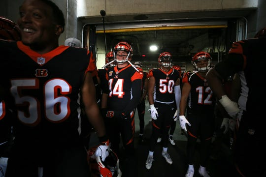 Cincinnati Bengals quarterback Andy Dalton (14) and the Cincinnati Bengals offense get set to take the field in the tunnel before the Week 6 NFL game between the Pittsburgh Steelers and the Cincinnati Bengals, Sunday, Oct. 14, 2018, at Paul Brown Stadium in Cincinnati. It was tied 14-14 at the half.